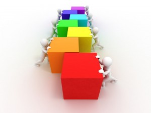 Little-white-men-pushing-colored-cubes